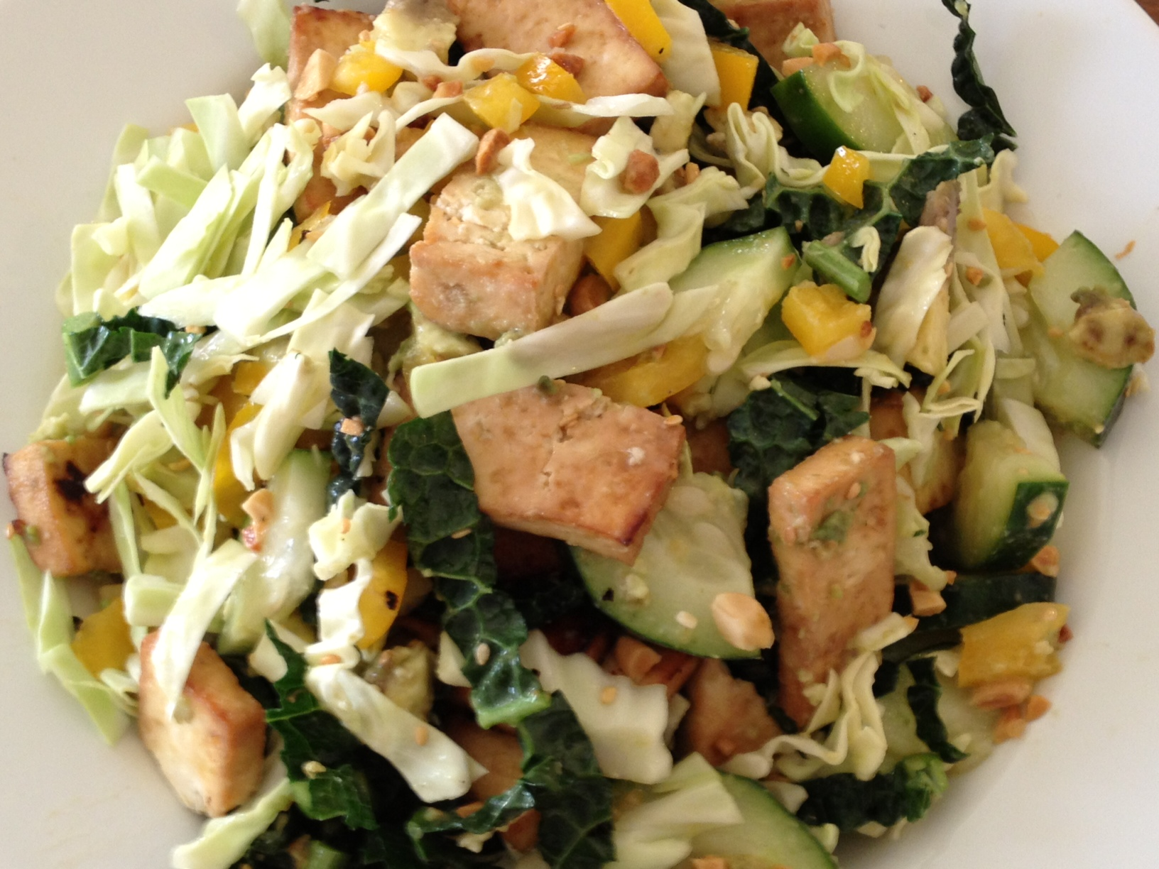 Once the tofu is ready, add to the salad and toss with the dressing ...
