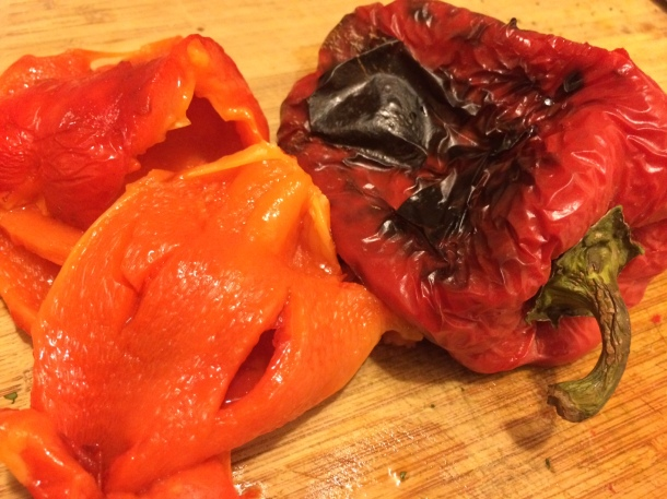 Roasted red peppers, before and after peeling.