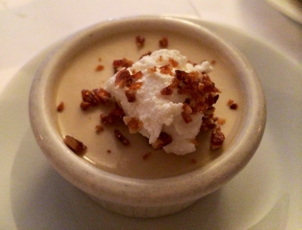 Butterscotch pot de creme with bourbon whipped cream and hazelnut praline.