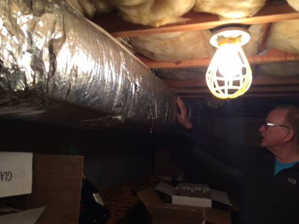 The central a/c duct running through the wine room.